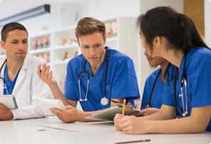 medical students studying with doctor